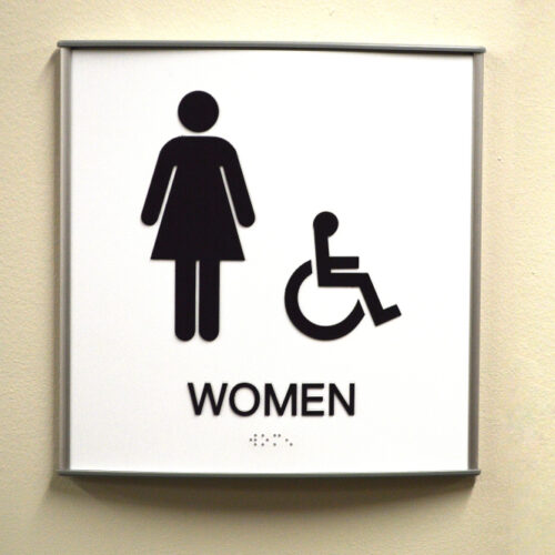 Women public restroom sign posted commonly in business offices and public facilities_