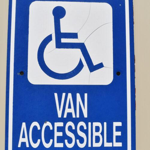 Handicap,Van,Accessible,Sign,On,A,Wall