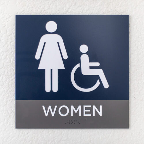 Blue,Womens,Bathroom,Sign,On,A,White,Wall