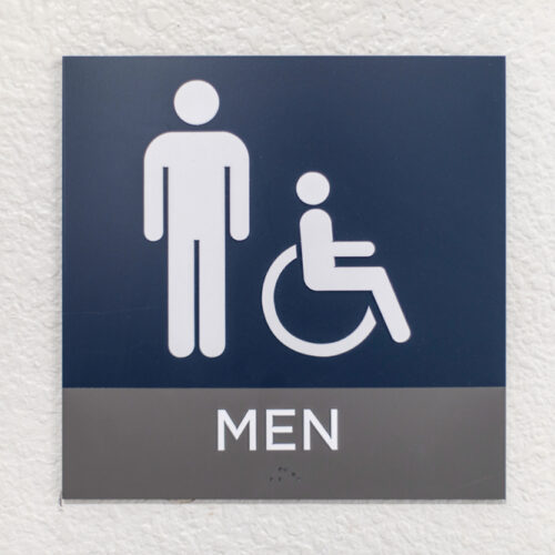 Blue,Mens,Bathroom,Sign,On,A,White,Wall